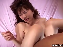 Asian temptress getting her wet pussy hammered in
