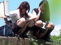 Oriental teens pissing